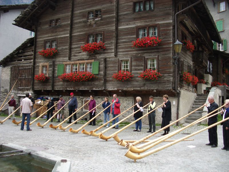 File:Alphorn players in Vals Switzerland.JPG