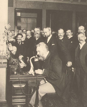 Alexander Graham Bell speaking by telephone.jpg