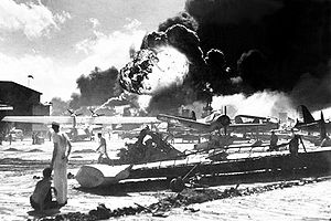 Captured Japanese photograph taken during the attack on Pearl Harbor, December 7, 1941. In the distance, the smoke rises from Hickam Field. (Navy)