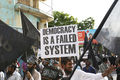 Street protest calling for Sharia in Maldives, Democracy failed system poster.jpg